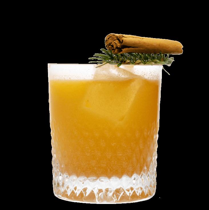 Weihnachts Gin Drink mit THE DUKE Gin, Mandarinensaft und Lebkuchen in Gin Glas mit Weihnachtlicher Dekoration
